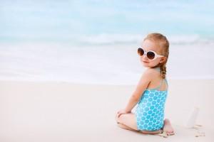 baby girl sea blue sunglasses sand