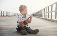 Boy with guitar baby names inspired by music