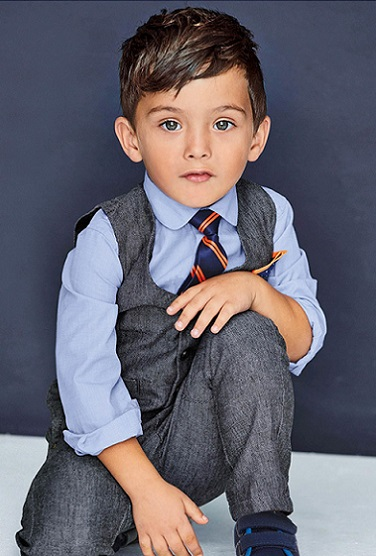 boy in blue shirt - baby names inspired by fashion